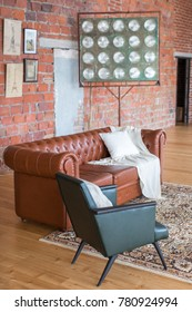 Design studio loft style in which there is a brown sofa