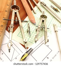 Design Time.  Conglomerate of antique drafting tools on engineering paper and wood background.