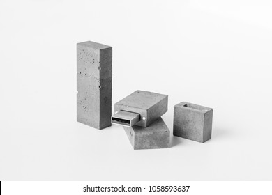 Design USB flash drive made of concrete with a cap on magnets on white background.
