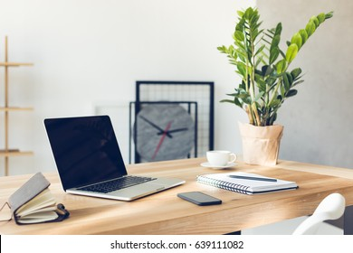 design of workplace in home office with modern equipment and objects