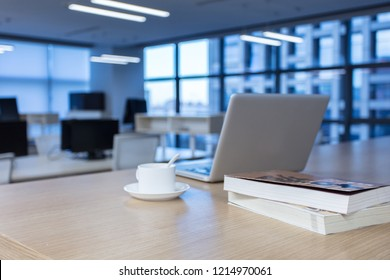 design of workplace with laptop and cup of coffee in modern office
