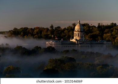 Designed by Frank Mills Andrews, the Kentucky State Capitol, seen on a foggy sunrise, was designed in the Beaux-Arts style and built in Frankfort, Kentucky.