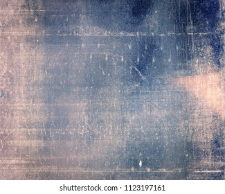 Designed grungy medium format film background with heavy grain, dust and light leak