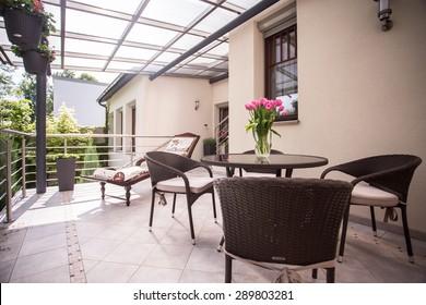 Designed wicker furniture on the cozy balcony