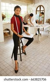 designer concept : Fashion designer working near mannequin in office
