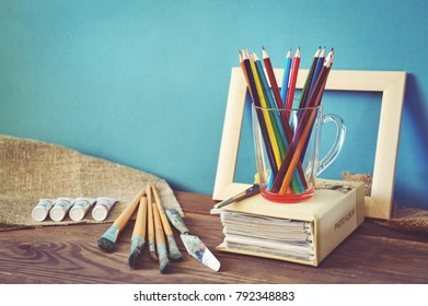 Designer desk with colored crayons, brush, pencils and paints. Top view . Flat lay image.Working desk table concept. - Shutterstock ID 792348883
