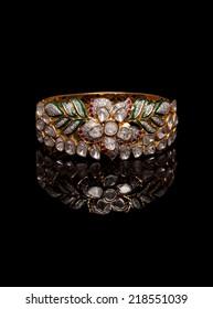 Designer diamond bracelet with many stones on reflective background