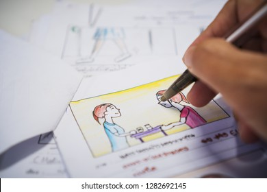 Designer drawing Story board movie video layout for pre-production, development cartoon illustration animation for process media films in form displayed script film production. Media product concept.