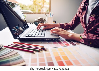 designer graphic creative ,creativity woman  working on laptop and designing  coloring colour ideas style