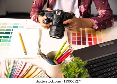 designer graphic creative ,creativity woman  working on camara and designing  coloring colour ideas style