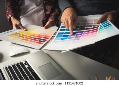 designer graphic creative ,creativity woman  working on laptop and designing  coloring color ideas style