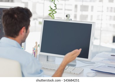 Designer having a video chat on his computer