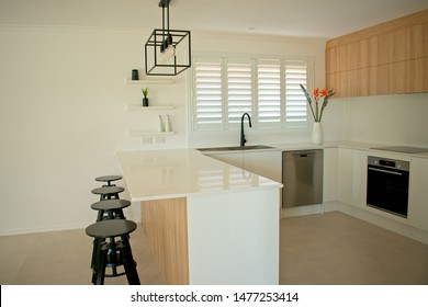 Designer kitchen with cabinets and stainless steel appliances.