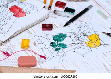 designer makes a sketch of the interior. background - drawing, markers, pencil, eraser, ruler, paints, calculator