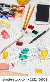 designer makes a sketch of the interior. background - drawing, markers, pencil, eraser, ruler, calculator