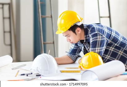 designer and male civil engineer design an idea for home and industrial construction project in business office for construction with happy home and safety concept