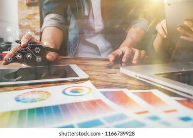 designer man using smart phone for mobile payments online shopping the double exposure image,omni channel,sitting on table,virtual icons graphics interface screen in warm colours sun light