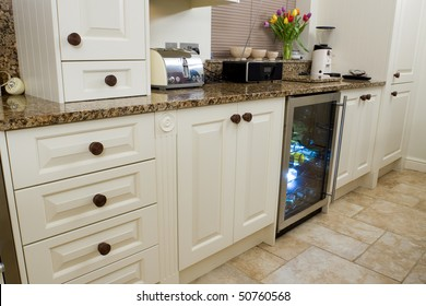 Designer modern kitchen interior with granite worktop and cream units