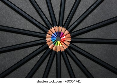 Designer pencils arranged in a circle like spokes