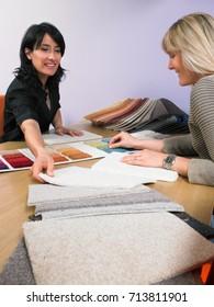 Designer showing carpet samples