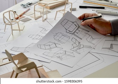 Designer sketching drawing design development product plan draft chair armchair Wingback Interior furniture prototype manufacturing production. designer studio concept .