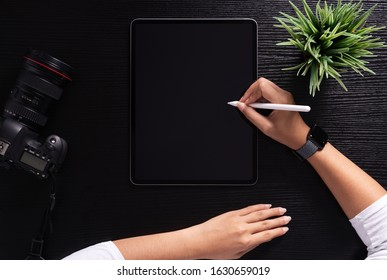 designer using stylus pen on top view
