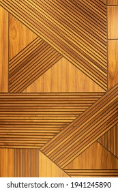 Designer walnut veneer panel, geometric crisscross pattern wood wall. Architectural background, texture. The concept is a modern interior, natural materials, minimalism style. Vertical.