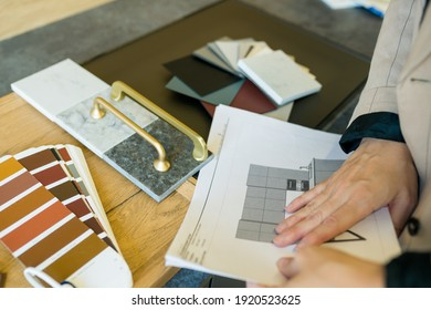 Designer woman choosing details of new kitchen in a home improvement store. Real estate, home renovation, small business concept