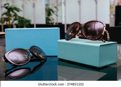 Designer Women's Sunglasses with turquoise boxes