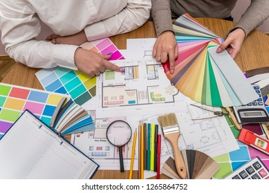 Designer working with color palette at office