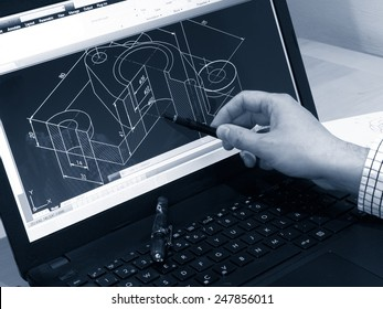 designer working on a cad blueprint monochrome image