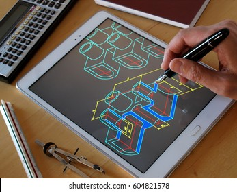 designer working on a cad blueprint using tablet computer