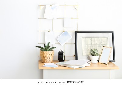 Designer working place at home with plants and moodboard