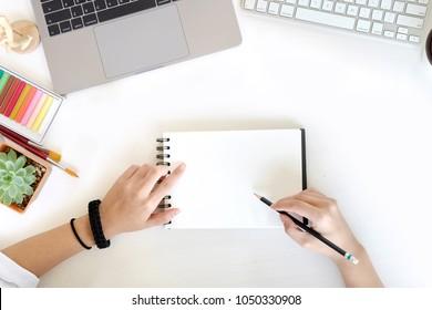 Designer working sketch drawing on desk workplace.