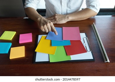 Designers choose colors from the color bands samples for design .Designer creativity work concept.