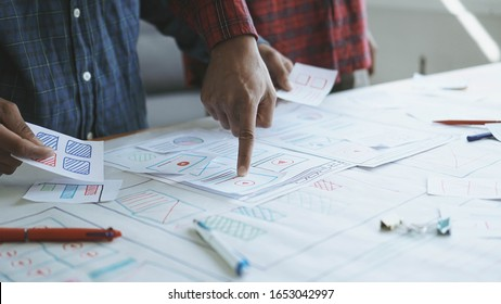 Designers man drawing (UX) (UI) Graphic designer creative sketch planning application process development prototype for responsive web desig