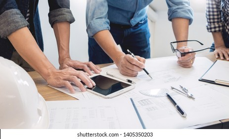 designers in the office are working Discussion Blueprint Architect on a new project Design Draw Teamwork on wooden desk