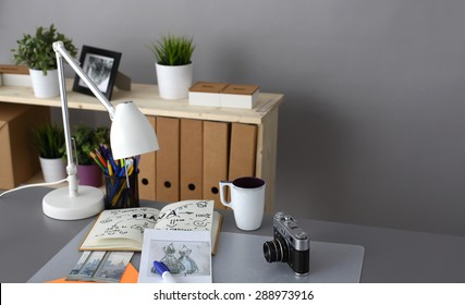 Designers table with camera and tools