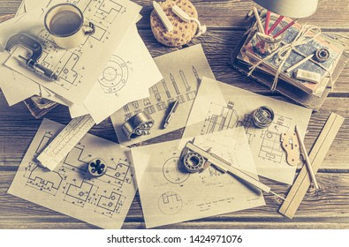 Designing mechanical parts by engineer on green blackboard background