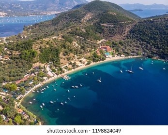 Desimi Beach Golf and nearby Island with clear water in Greece in summer.