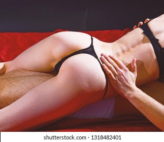 Desire and erotic. Safer sex helps you stay healthy and can even make sex better. Guide to safe sex basics. Couple naked make love in bed. Female sexy buttocks and male body. Sexual health and libido.