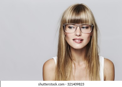Desirous young student in spectacles