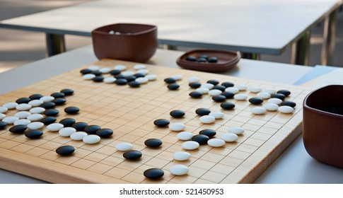 Desk for board game Go and black and white bones. Go or wei-Chi - traditional asian board game