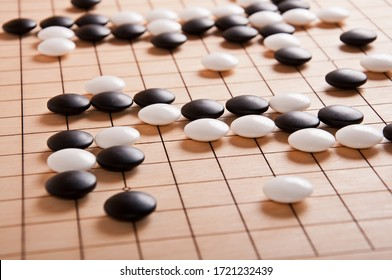 Desk for board game Go (weiqi) and black and white bones. Traditional asian strategy boardgame