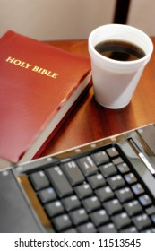Desk of Businessperson of Faith or Pastor's Desk – can represent tradition and technology, modern Bible study, faith in modern culture, etc. (shallow focus on Bible & coffee, slight glow effect).