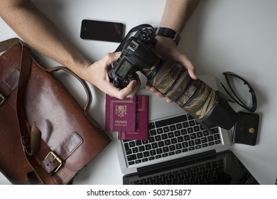 desk with camera equipment and passports