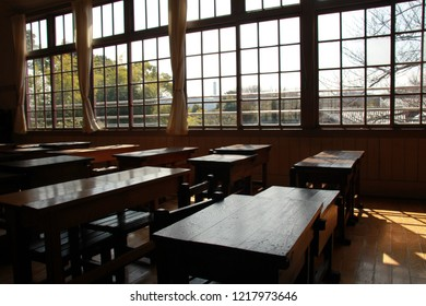 A desk and a chair in a nostalgic classroom of wooden Japan