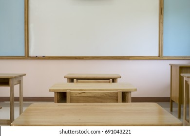 desk in classroom with whiteboard