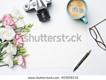desk with coffee and flowers