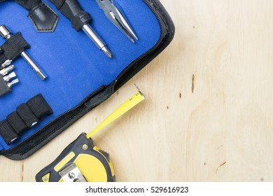 Desk of a craftsman tools on a wooden background. top view, flat lay concept.